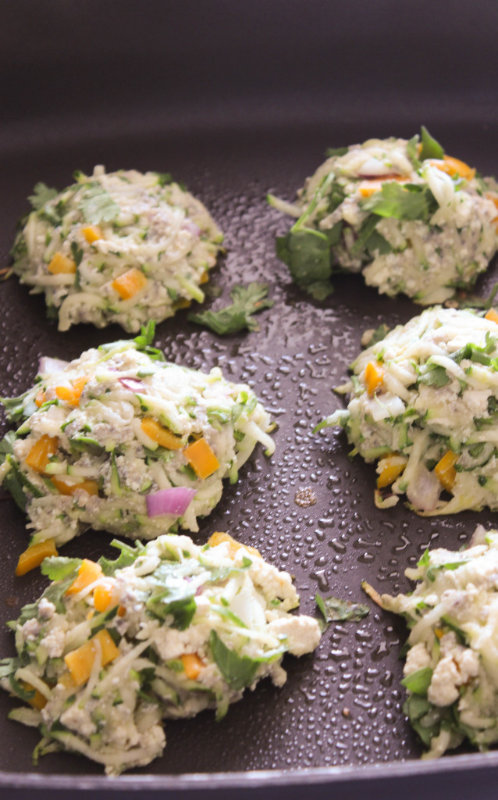 Zucchini fritters packed with lots of fresh herbs and a mound of zucchini. Eat them for breakfast, lunch, or dinner. Zucchini fritters all day long!