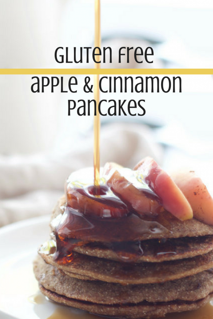 apple and cinnamon gluten free pancake stack with sliced apple on top being drizzled with maple syrup