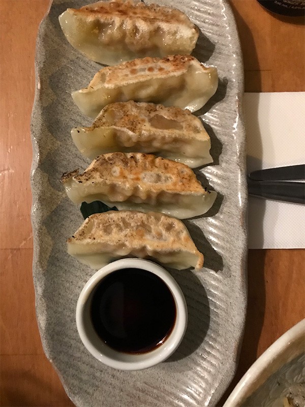 Plate of vegan gyoza and dipping sauce. Photo taken at Sister of Soul St Kilda