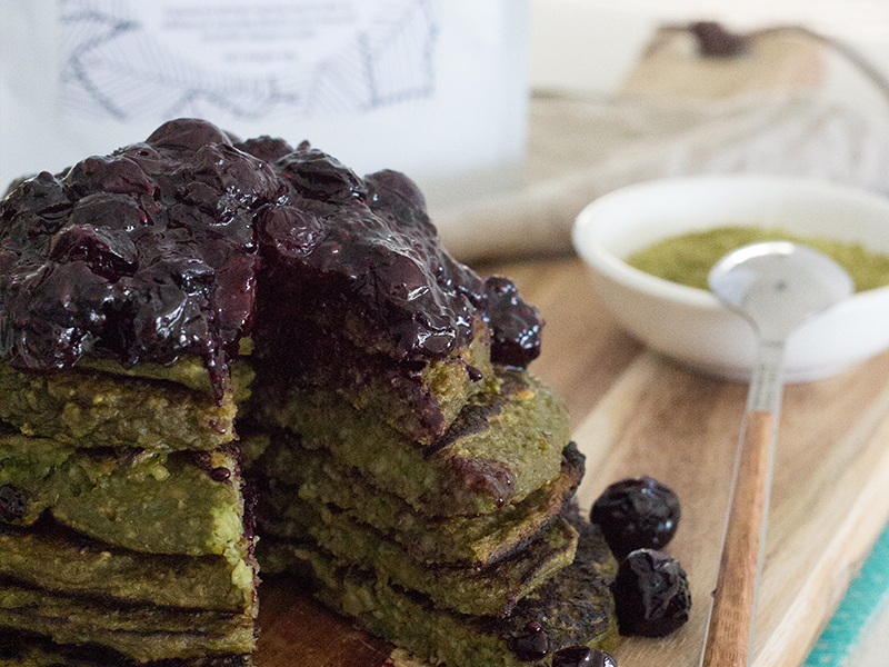 stack of matcha pancakes with blueberry chia jam