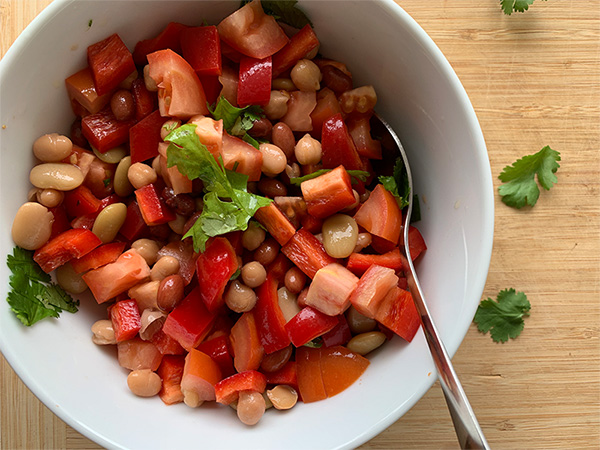 White bowl filled with bean salad.